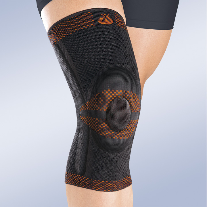 CLOSED PATELLA KNEE BRACE W/SILICONE PAD and LATERAL FLEXIBLE REINFORCEMENT