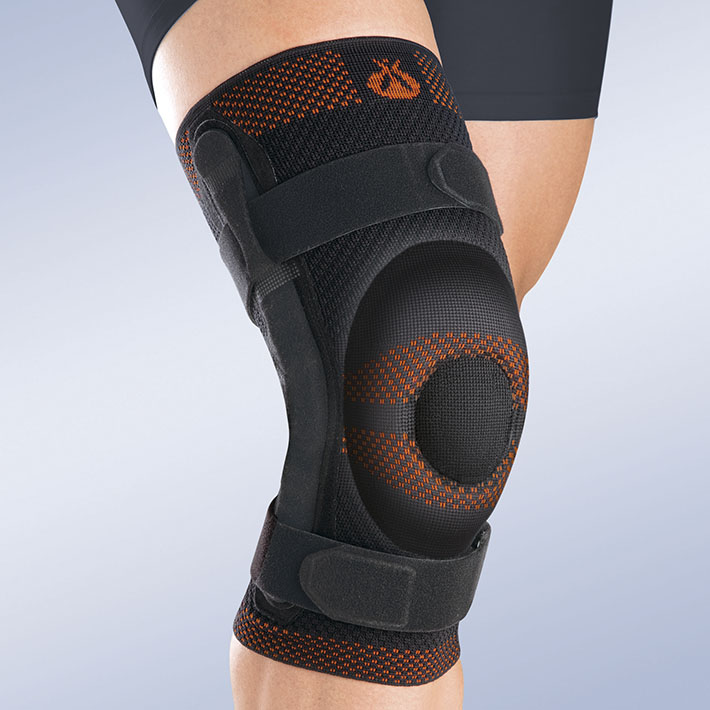 CLOSED PATELLA KNEE BRACE W/ SILICONE PAD AND POLYCENTRIC REINFORCEMENTS