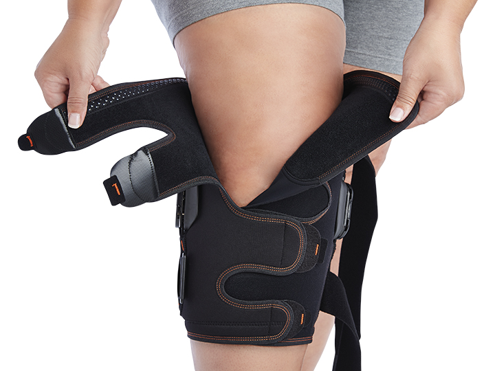 WRAPAROUND KNEE SUPPORT FEATURING JOINTS WITH FLEXION/EXTENSION CONTROL